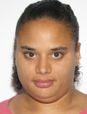 Photo of Rochelle Simms, a heavyset young woman with tan skin and black curly hair.