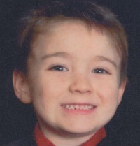 Photo of Gary Blanton III. He has fair skin and light brown hair. He is smiling for the camera.