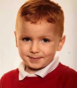 Portrait photo of a small redheaded boy.