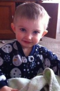 Photo of Brayson Price, a small boy in snowman pajamas, with fair skin and blond hair.