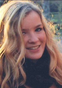 Sophie Bennett, a teenage girl with long, curly blonde hair, smiling for the camera.