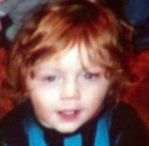 Photo of a toddler boy with bright red hair.