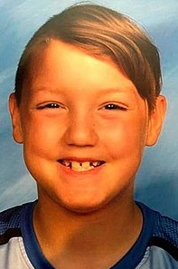 Photo of JJ Vallow, a boy with straight blond hair, smiling for the camera.
